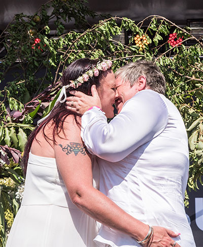 lesbian couple kissing wedding in Melbourne
