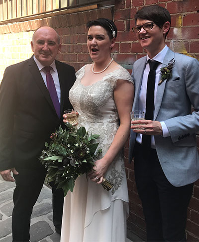 lesbian couple with gay celebrant in Melbourne